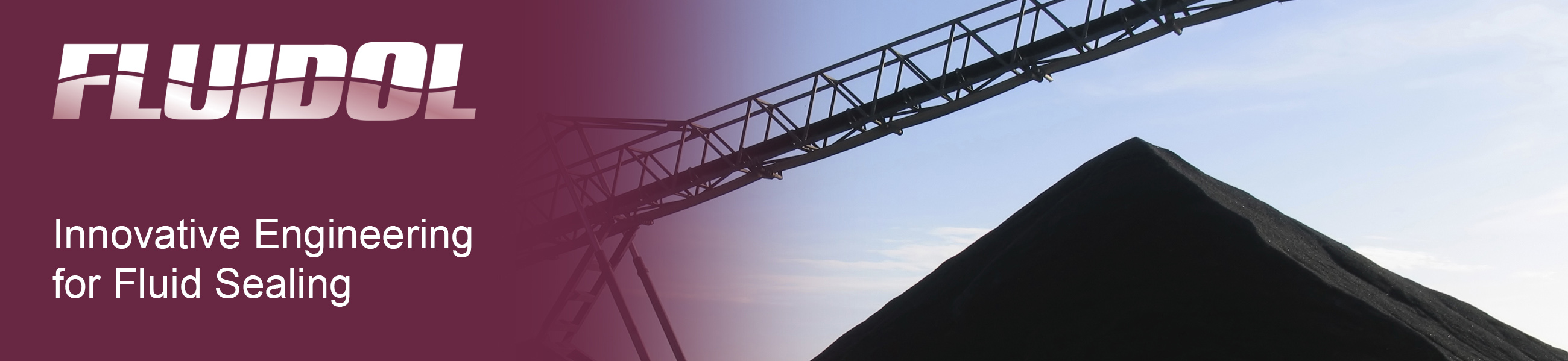 A large pile of coal shown with a conveyor belt.